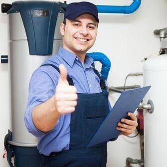 Picture of a licensed plumber on the job doing an inspection