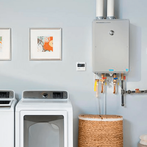 Picture of a beautiful space-saving tankless water heater setup in the laundry room